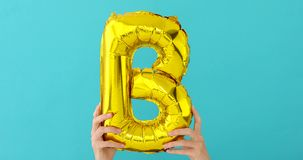 Ballong för beröm för bokstav B för guld- folie lager videofilmer