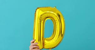 Ballong för beröm för bokstav D för guld- folie lager videofilmer