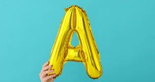 Ballong för beröm för bokstav A för guld- folie stock video