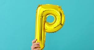 Ballong för beröm för bokstav P för guld- folie stock video