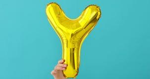 Ballong för beröm för bokstav Y för guld- folie lager videofilmer