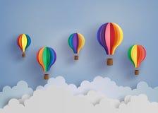 Ballong och moln för varm luft Arkivbild