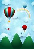 Ballonger för varm luft över berget Royaltyfri Fotografi