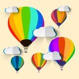 Ballonger för varm luft med moln Arkivbild