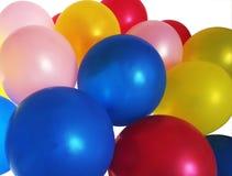 ballonger fyllde heliumdeltagaren royaltyfri foto