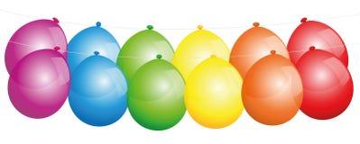 Ballonger i en linje regnbågefärger Arkivbild