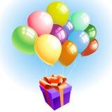 Ballonger med en gåva Royaltyfri Fotografi