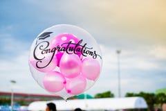 Ballonger med lyckönskantext Arkivbild
