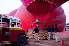 Balloning in Bagan, Myanmar. BAGAN, MYANMAR - JANUARY 7: Men holding hot air balloon - proper training to fly a balloon on January 7, 2011 in Bagan, Myanmar Royalty Free Stock Image
