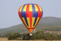 Ballons. Balloon in the sky over green hills Stock Photo