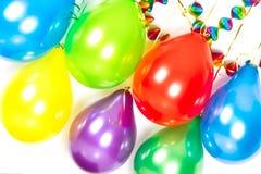 Ballons coloridos e festões. Decoração do partido Imagem de Stock