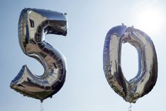 Ballons d'hélium pour un cinquantième Image stock