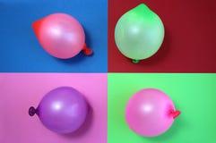 Ballons de différentes couleurs sur un fond différent photos libres de droits
