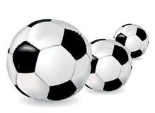 Ballons de football noirs et blancs Photographie stock