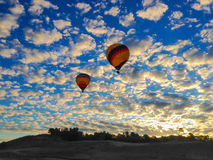 Ballons de lever de soleil Photographie stock libre de droits