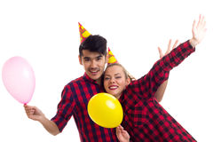 Ballons de soufflement de jeunes couples Photo libre de droits
