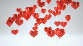 Ballons de vol sous forme de coeur banque de vidéos