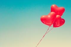Ballons en forme de coeur rouges Images libres de droits