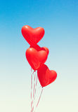 Ballons en forme de coeur rouges Images stock
