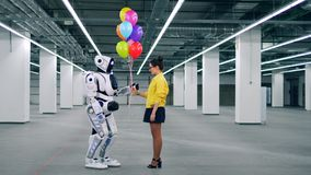 Ballons gifting d'une fille à un robot dans une chambre clips vidéos