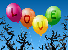 Balloons Love. Four balloons, which are labeled with the word LOVE, are threatened by thorns Royalty Free Stock Photography