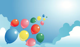Ballons multicolores dans un ciel Photographie stock