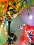 Ballons & Olives. Shot of a pair of martini glasses, one of them filled up with olives. Curly ribbons and balloons give the picture a party/celebration felling royalty free stock images