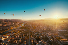 Ballons over Avanos town in Cappadocia. Royalty Free Stock Photo