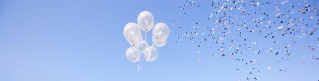 Ballons party over a blue sky Stock Photo