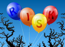 Balloons Risk. Four balloons, which are labeled with the word RISK, are threatened by thorns Royalty Free Stock Photography
