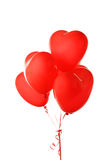 Ballons rouges de coeur d'isolement sur un blanc Photos stock
