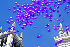 Balloons in sky. Balloons in purple in sky with cathedral background Stock Image