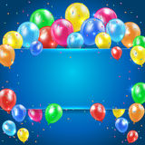 Ballons sur le fond bleu avec la bannière Photographie stock libre de droits