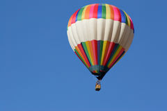 Balloon. Colorful Hot air balloon flying high into blue sky Royalty Free Stock Image