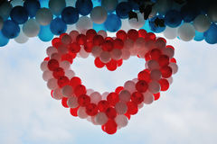 Balloon. Red heart of helium balloons Royalty Free Stock Image