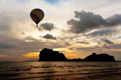 Balloon above black mountain Stock Photos