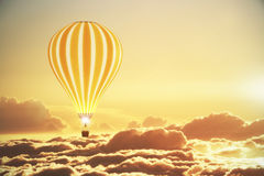 Balloon above the clouds at sunset Royalty Free Stock Photos