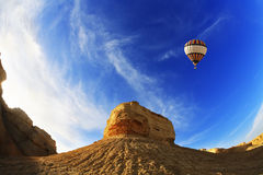 The balloon above mountains. A sunset Royalty Free Stock Image