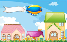 A balloon above the village with an empty banner Royalty Free Stock Photo
