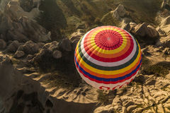 Balloon from abowe against a dramatic structered landscape Royalty Free Stock Photography