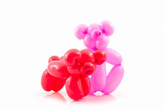 Balloon animal of red pig and pink bear. Royalty Free Stock Photography