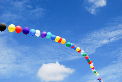 Balloon arc in the sky Stock Photo
