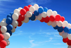 Balloon arch. Red white and blue patriotic balloons on pretty blue sky Stock Photo