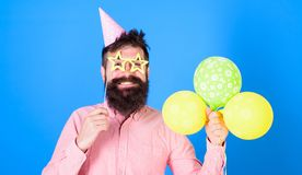 Balloon artist at birthday party. Bearded man entertaining kids at International children day celebration. Smiling man. With trendy beard and mustache holding Royalty Free Stock Photo