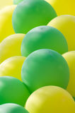 Balloon background. Yellow and green balloons background Stock Photo