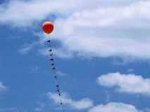 Balloon and Banners. Against a blue sky with white clouds Royalty Free Stock Images