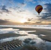 Balloon at beach on sunrise Stock Image