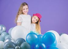 Balloon birthday party. Girls little siblings near air balloons. Birthday party. Happiness and cheerful moments. Carefree childhood. Start this party. Sisters stock image