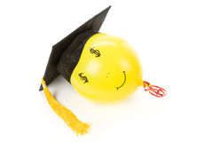 Balloon and Black Mortarboard Royalty Free Stock Images