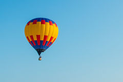 The balloon on the blue sky background Stock Photography